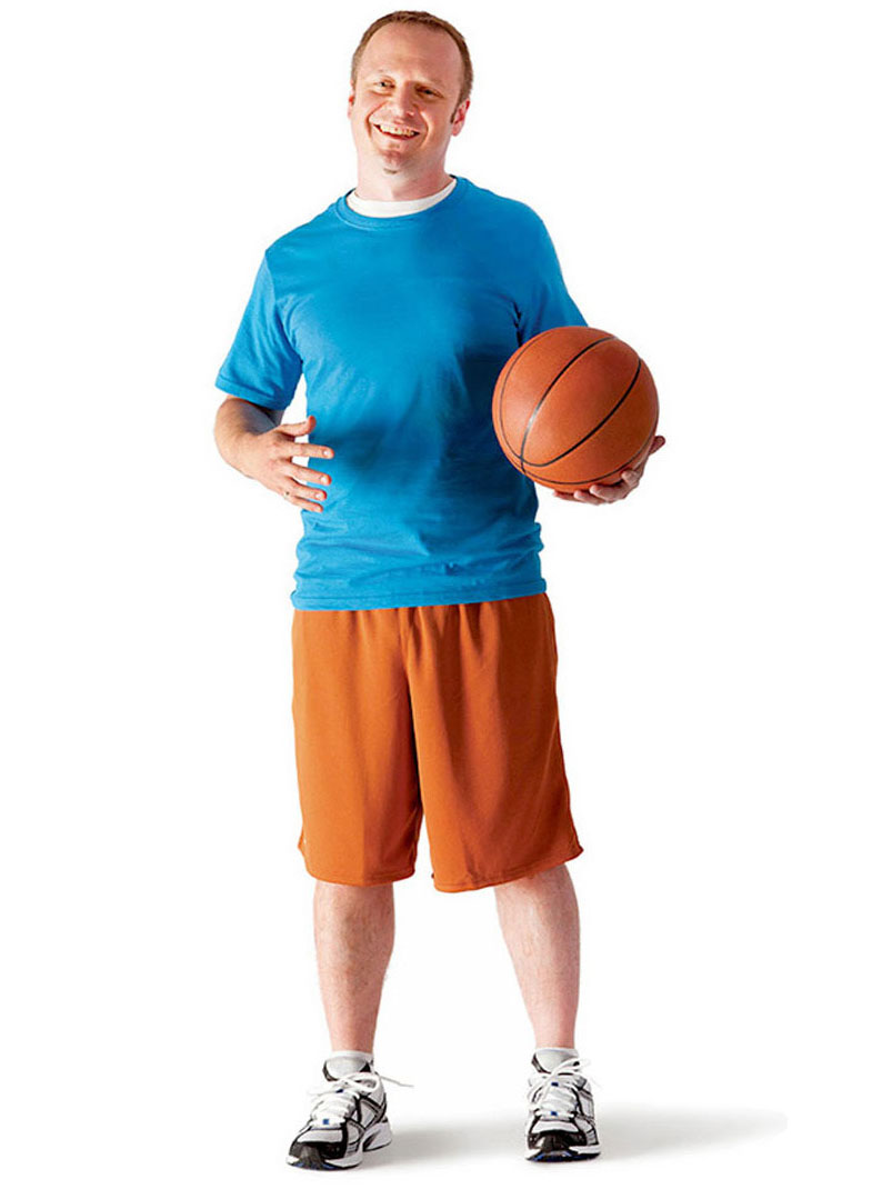 an adult holding a basketball
