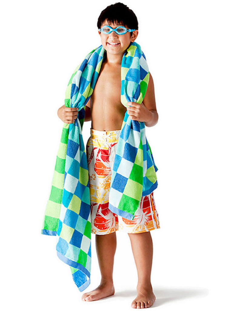a boy with a swimsuit and towel