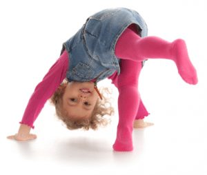 a little girl doing a handstand