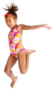 a girl jiumping in the air with a swimsuit