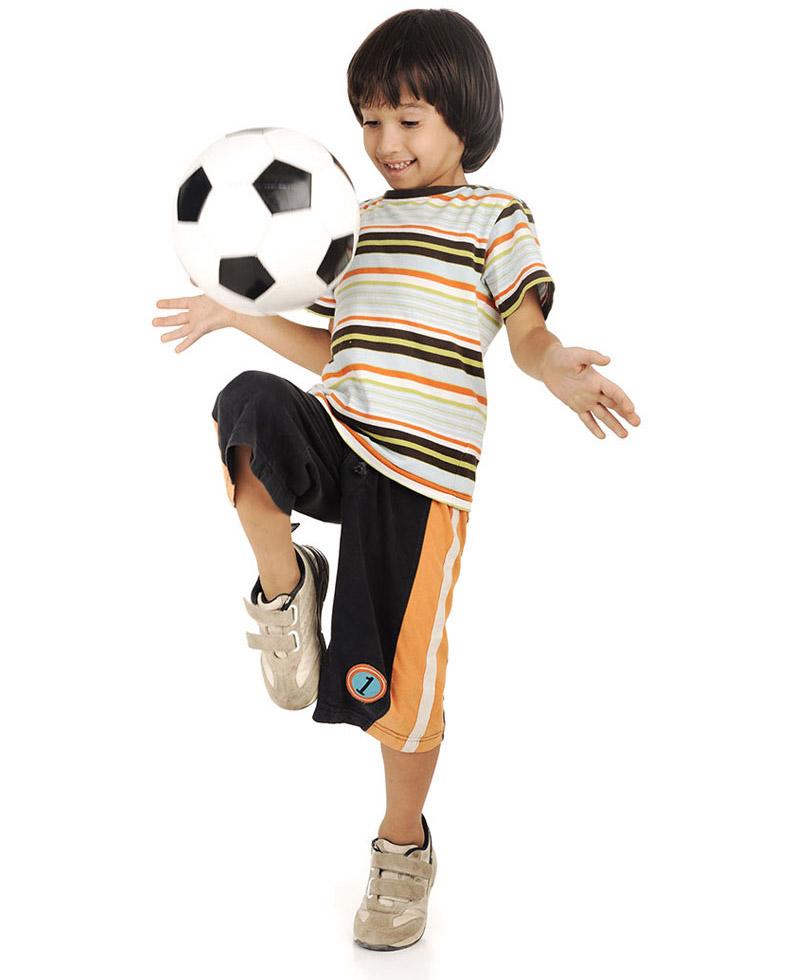 a child doing soccer tricks