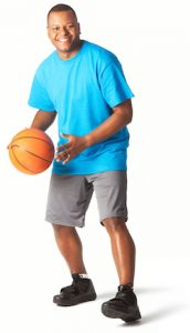 an african american male playing with a basketball