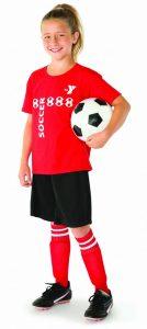 a girl holding a soccer ball