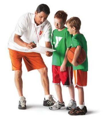 an adult coaching a boys youth basketball team.