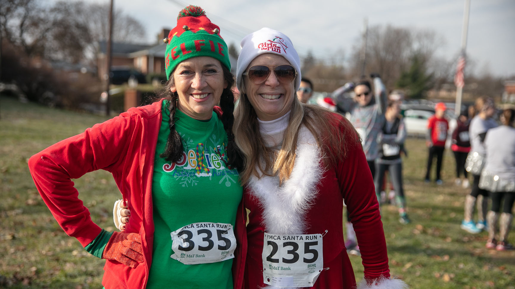 Photo of two women dressed up in red and green for Santa Run