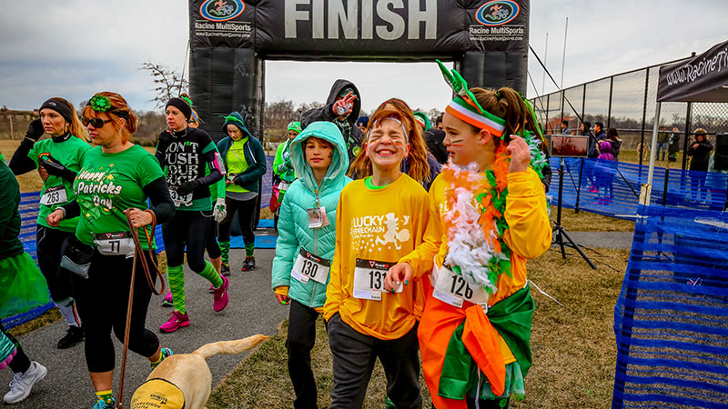 kids and adults at a lucky leprechaun run