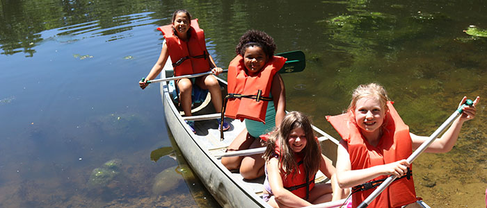 children going canoeing