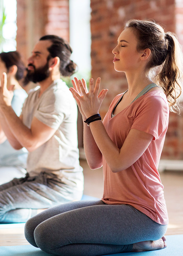 a man and woman doing yoga