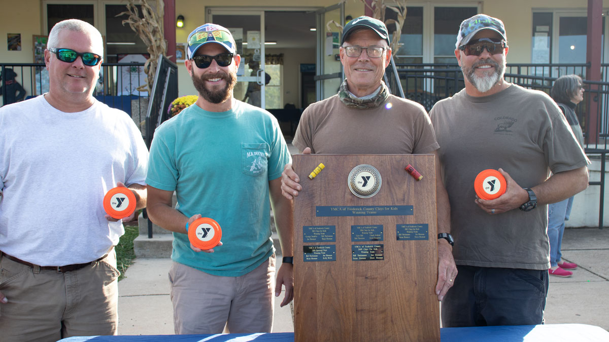 Team from Sporting Clays Tournament holding winning trophy