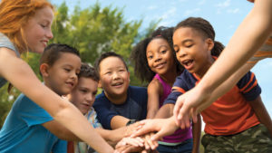 group of diverse kids at summer camp