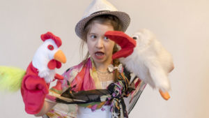 girl with puppets at puppetry camp