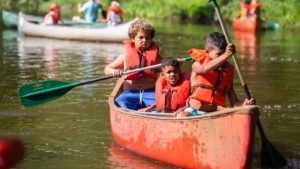 kids in a canoe at Camp West Mar