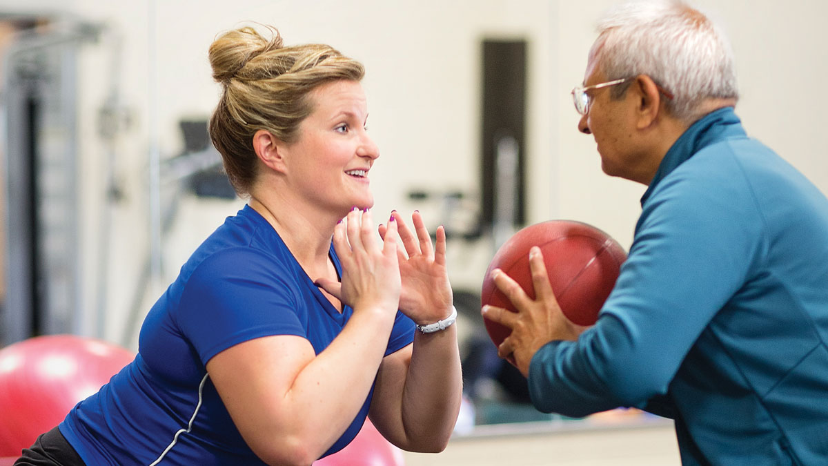 older male with personal trainer