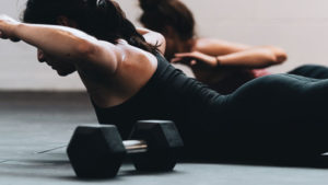 girl in gym with dumbell