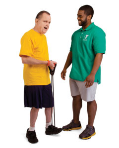 Y staff member and blind person using stretch band
