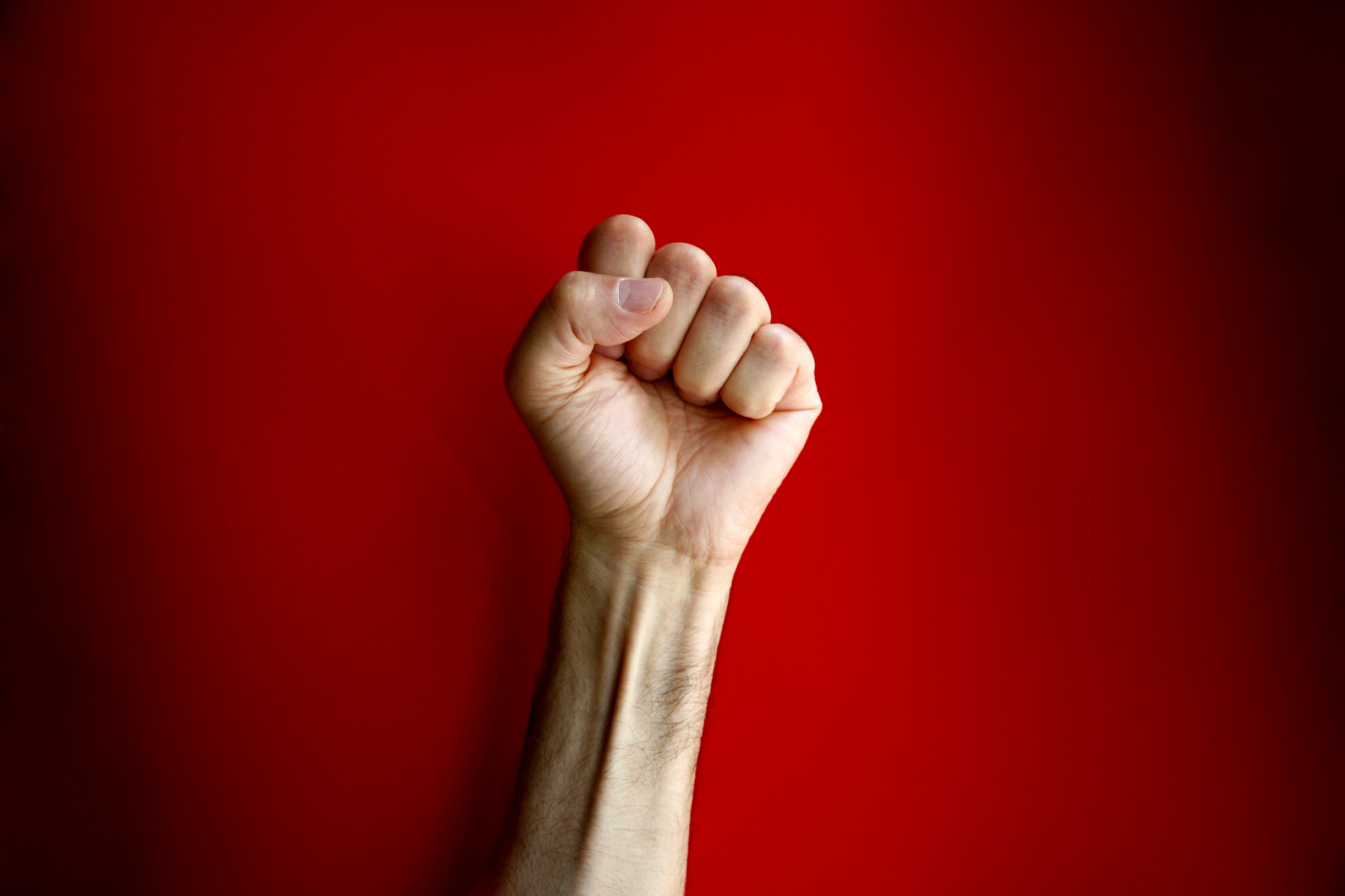 Clenched Fist on Red Background - CARP