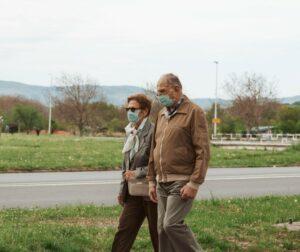 Senior couple wearing surgical masls