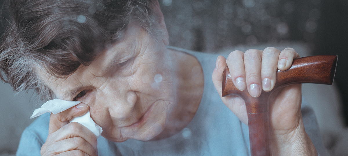 Upset older woman drying tears