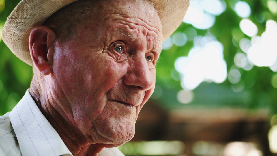 Older man wearing a hat outdoors