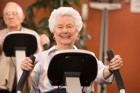 alzheimers-seniors-working-out-on-exercise-bike-in-gym-gettyimages