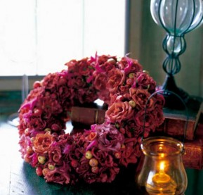 decor-fall--wreath-of-rose-and-cranberry-on-table-gettyimages
