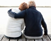 couple-sitting-on-pier-looking-gettyimages