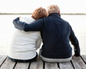 resized-couple-sitting-on-pier-looking-gettyimages