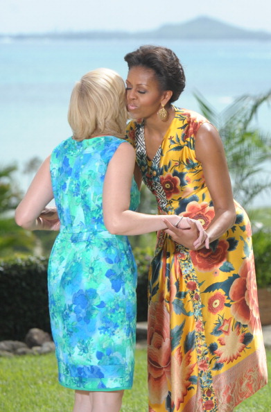 US First Lady Michelle Obama (R) greets