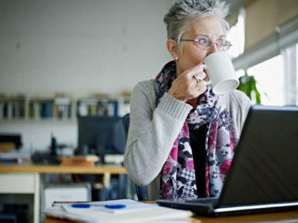 businesswoman-sitting-in-office-drinking-gettyimages