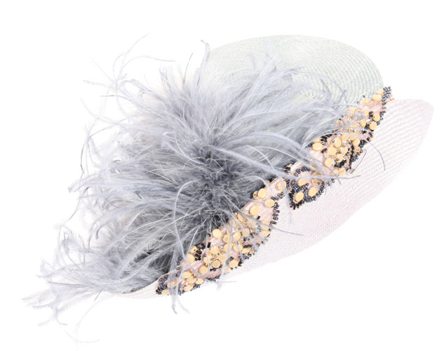 Feathered hat, $225, Lilliput-Hats, www.lilliputhats.ca