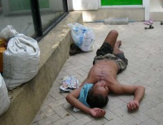Homeless-man-lying-on-street-Story#4-Observations-of-a-Political-Junkie