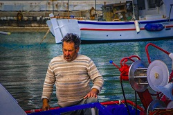 A fisherman in the Skiathos Harbor