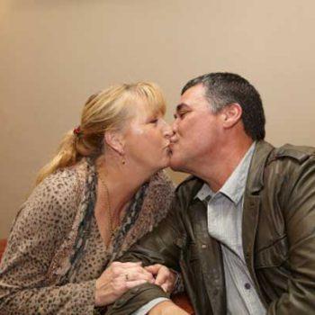 Mature woman kissing woman