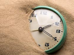 Alarm clock in sand