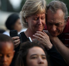 mandela-couple-embraces-as-they-mourn-at-a-shrine-of-gettyimages
