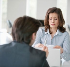 businesswoman-upset-while-looking-at-a-bill-gettyimages