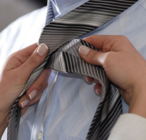 colette-woman-helping-to-fasten-a-necktie-gettyimages[1]