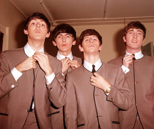"The Book. Volume 1: Page 12, Picture 8. 1963. A picture of the legendary English rock group ""The Beatles"". L-R: Paul McCartney, George Harrison, Ringo Starr, and John Lennon."