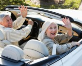 couple-driving-away-in-convertible-gettyimages