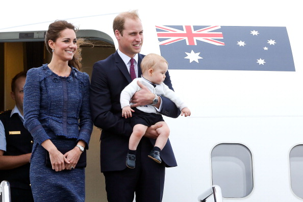 WELLINGTON, NEW ZEALAND - APRIL 16:  Catherine, Duchess of Cambridge, Prince William, Duke of Cambridge and Prince George of Cambridge look on before boarding a Royal Australian Air Force plane for their flight to Australia at Wellington Airport's military terminal April 16, 2014 in Wellington, New Zealand. The Duke and Duchess of Cambridge are on a three-week tour of Australia and New Zealand, the first official trip overseas with their son, Prince George of Cambridge. (Photo by Hagen Hopkins/Getty Images)