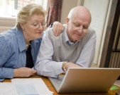 mature-couple-paying-bills-together-online-gettyimages