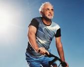 Mature man riding bike
