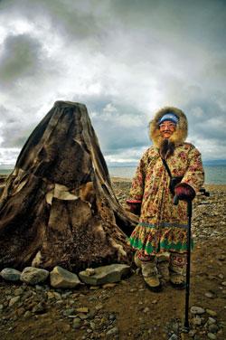 An Inuit Elder provides interpretation beside a traditional tent near Gjoa Haven.