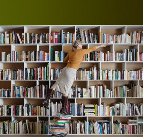 woman-reaching-for-books