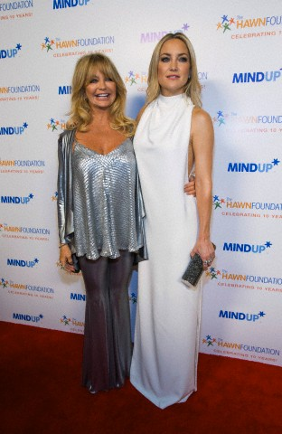 "Actress and host Goldie Hawn poses with her daughter and actress Kate Hudson at the inaugural ""Goldie's Love In for Kids"" benefit event in Beverly Hills"