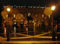 Rome's Piazza del Campidoglio on a rainy evening.