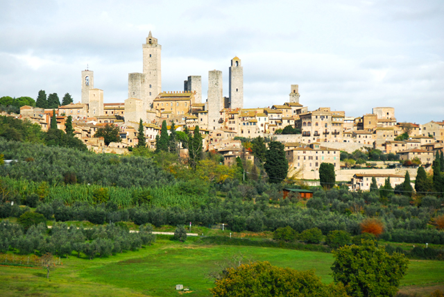 """San Gimignano, dubbed the """"medieval Manhattan"""" for its towers, looms over the Tuscan countryside."""