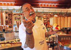Two-time world champion gelato maker Sergio Dondoli serves up scoops at his shop in San Gimignano's Piazza della Cisterna.