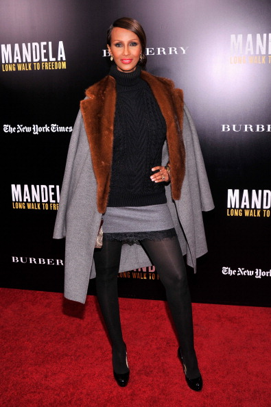"NEW YORK, NY - NOVEMBER 25: Model Iman attends ""Mandela: Long Walk To Freedom"" screening hosted by U2, Anna Wintour, Bob and Harvey Weinstein with Burberry at Ziegfeld Theater on November 25, 2013 in New York City. (Photo by Stephen Lovekin/Getty Images)"