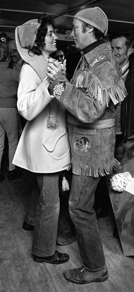 Canadian Prime Minister Pierre Trudeau, dressed in a colorful Indian jacket, delights his wife Margaret at a dance at this village near Montreal, Saturday March 27, 1971. Trudeaus attend a day long maple sugar party as one of their first public appearances since their recent wedding. (CP PHOTO/ Peter Bregg)
